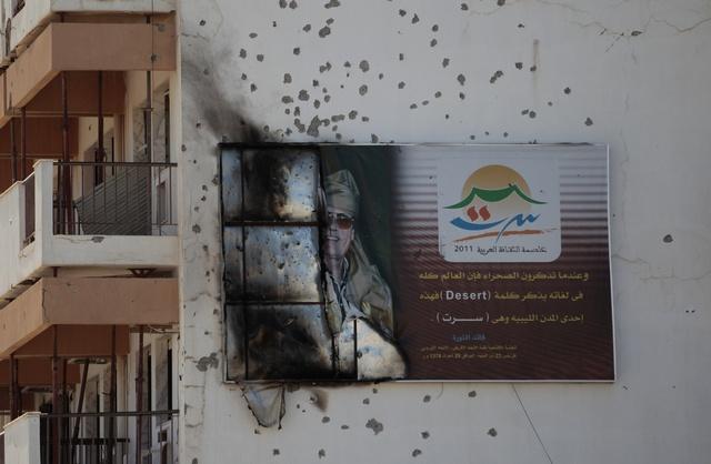 صورة ليبيا: يجب التحقيق في وفاة القذافي وابنه
